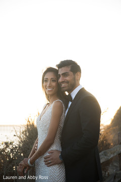 Indian couple posing by the sunset