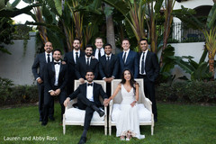 Indian bride and groom posing with groomsmen