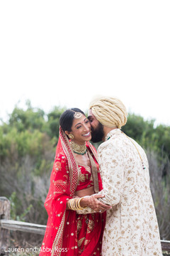 Indian bride being kissed by Raja