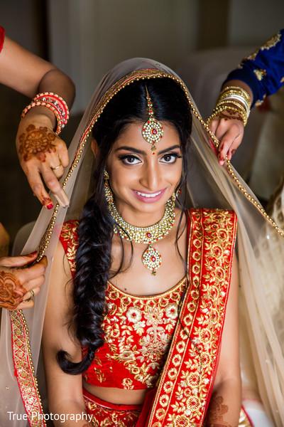 Indian bride getting her ghoonghat on.