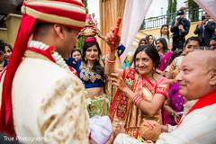 Elegant indian groom during baraat ritual.