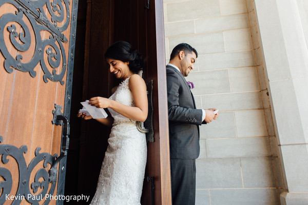 Indian couple reading the card from each other