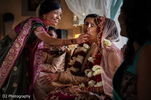 Indian bride getting food from her mother.