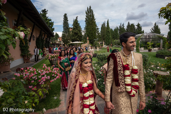 Indian couple walking out of ceremony.
