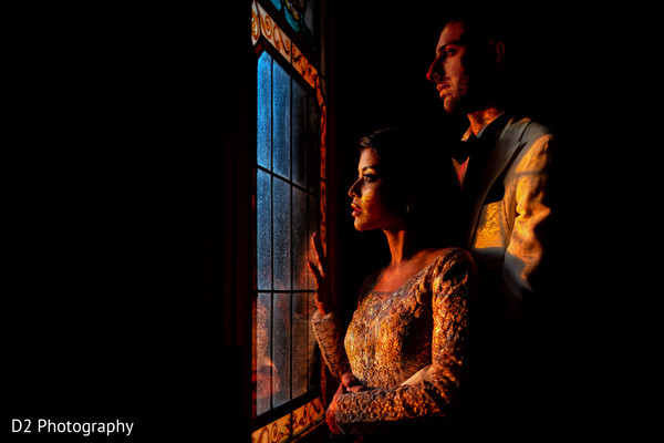 Dreamy capture of Indian couple looking out the window.