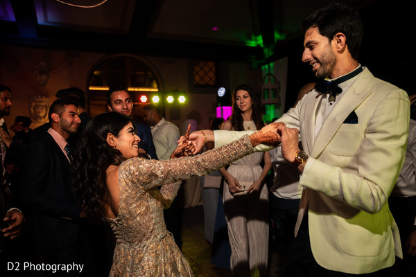 Lovely Indian couple at reception celebration dance.