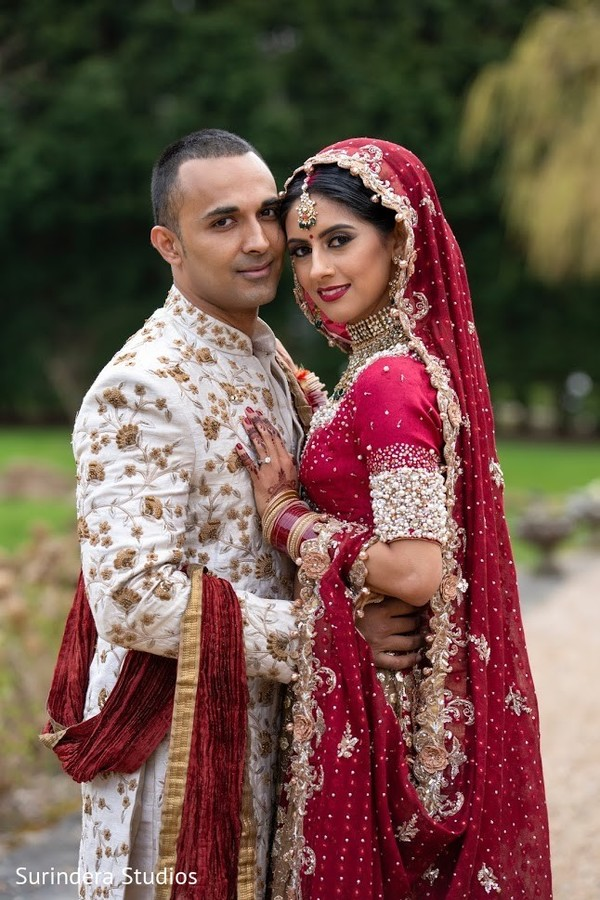 Happy Indian couple posing outdoors.