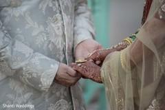 Maharani holding the Raja's hand