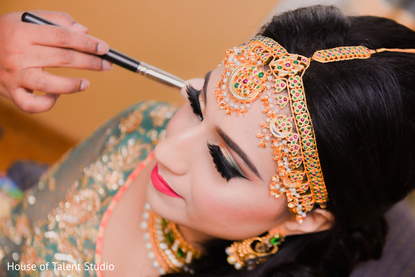 Indian bride getting her makeup done