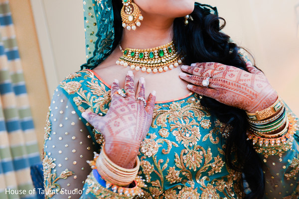 Indian bride showing her mehndi design