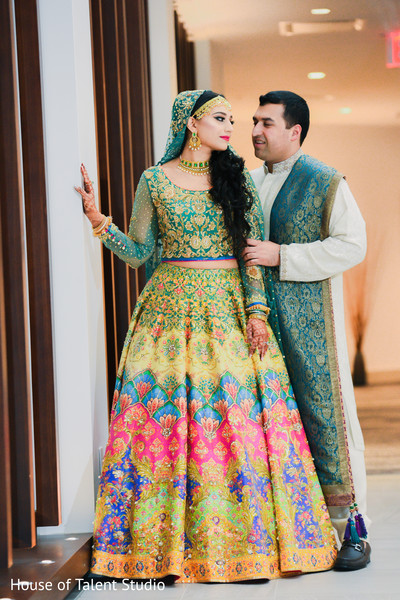 Indian bride and groom looking dazzling