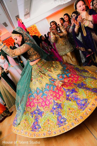 Indian bride showing her incredible lengha design