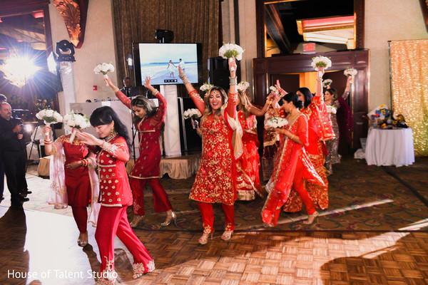 Indian bridesmaids entering the reception