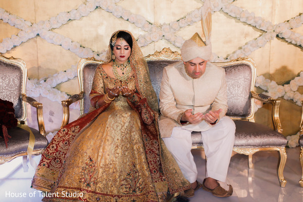 Indian bride and groom having a spiritual moment