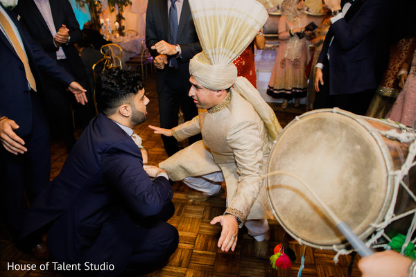 Indian groom dancing along the dhol