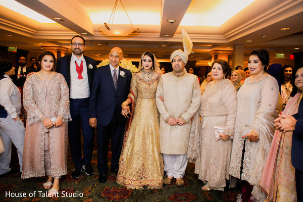 Maharani and Raja posing with special family guests