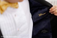 Elegant Indian groom's tuxedo signature.