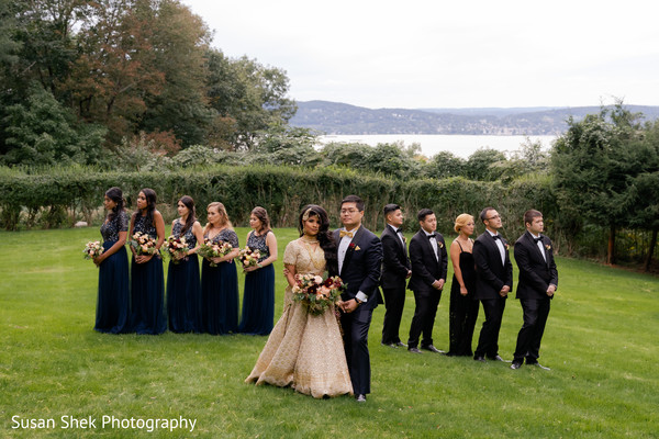Indian bride and groom with bridesmaids and groomsmen capture.