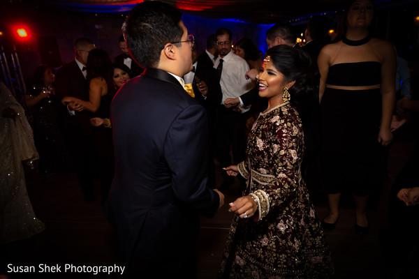 indian bride,indian wedding reception,dance,indian groom