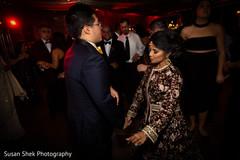 Indian bride and broom rocking the dance floor.