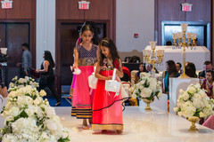 Cute flower girls entering indian wedding