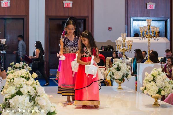 Cute flower girls entering indian wedding