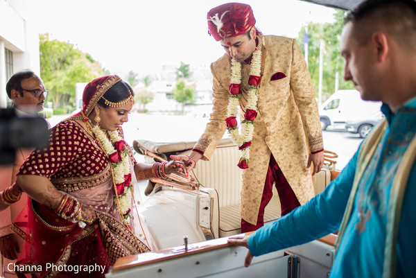 Indian bride getting in their just married car