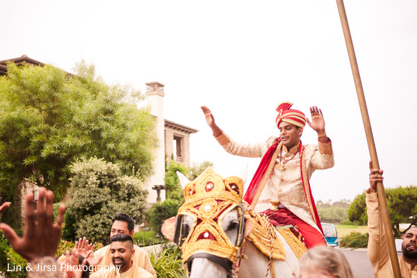 Indian groom enjoying the baraat