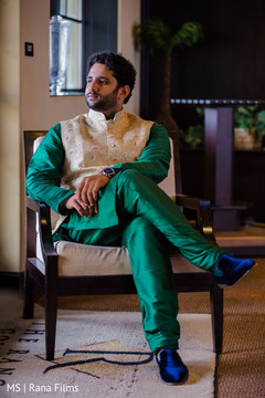 Indian groom wearing emerald green outfit
