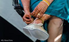 Indian bride putting on her ankle bracelet