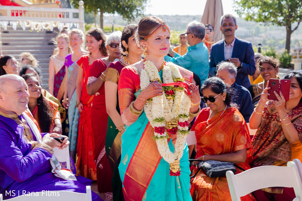 Indian bride walking down the aisle