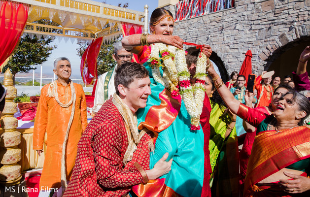 Indian bride lifted for garland exchange