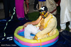 Indian groom at the pool during the pre wedding rituals