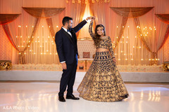 Indian bride and groom dancing for pictures