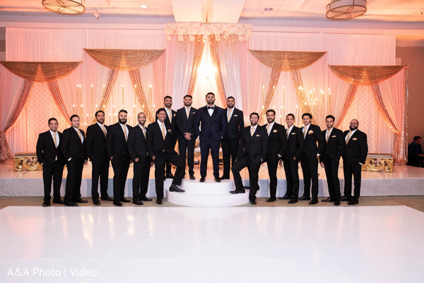 Groom and groomsmen posing during the reception