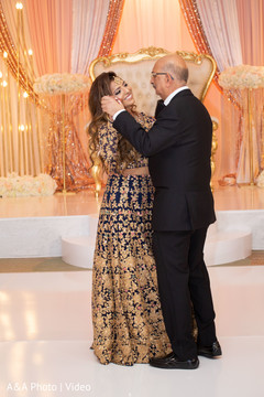 Indian bride dancing with her father