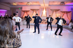 Indian groom and groomsmen performing a choreography