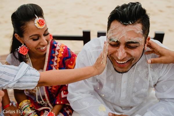Indian groom and bride during haldi