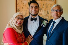 Indian groom posing with family