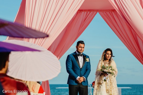 Indian groom and bride under the mandap