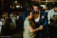 Indian groom dancing with special family guest