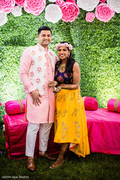 Indian bride and groom at the pre wedding rituals