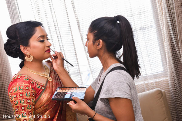 Maharani getting last touch ups of makeup.