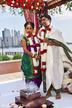 See this lovely Indian couple at ceremony rituals.