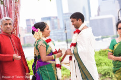 Indian couple exchanging rings capture.