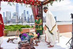 Maharani and rajah getting blessings from parents.