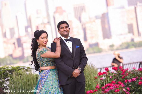 Joyful Indian  bride and groom posing outdoors.
