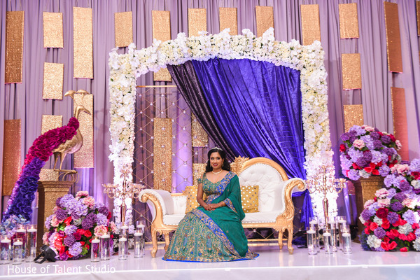 Indian bride at her wedding reception stage capture.
