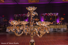 Indian wedding reception table chandelier backdrop.