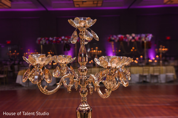 Indian wedding reception table chandelier backdrop.